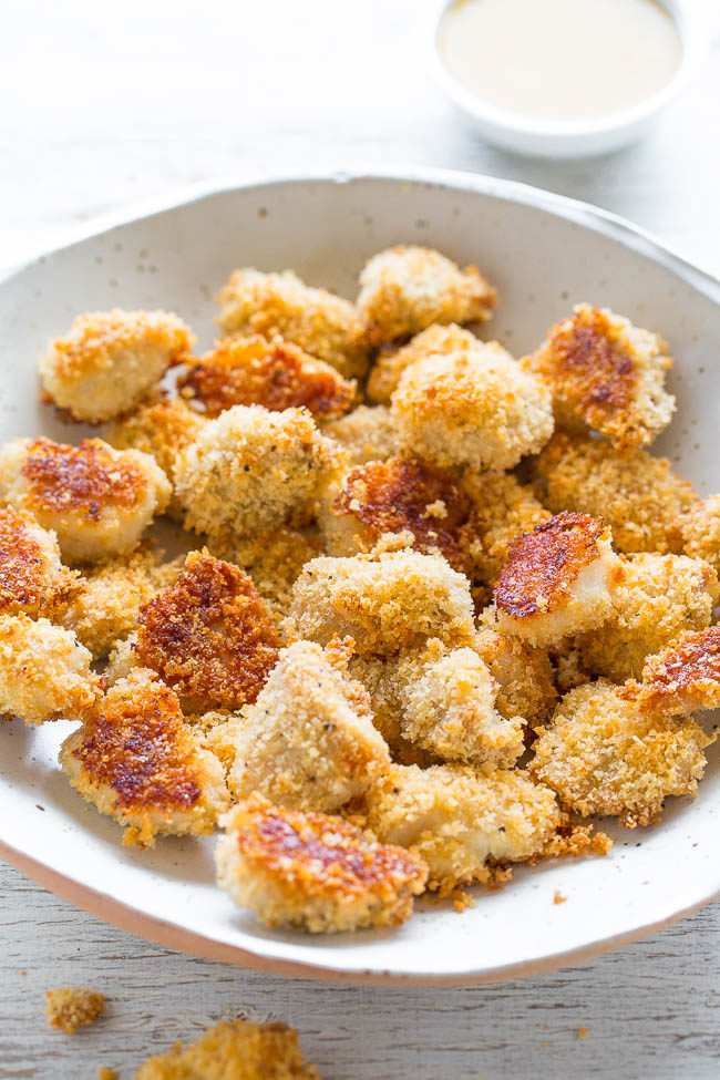 Baked Chicken Nuggets with Honey Mustard - You'll never guess they're BAKED and not fried!! CRISPY on the outside, tender and juicy inside! Goodbye storebought nuggets because homemade are way BETTER!!