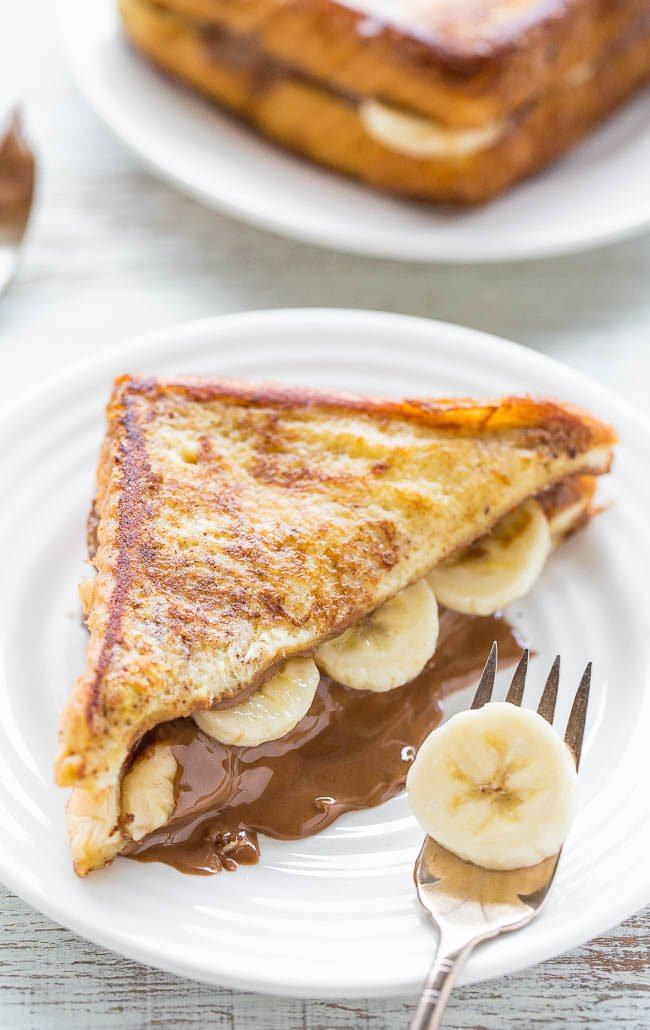 Chocolate Peanut Butter Banana-Stuffed French Toast - A decadent twist on peanut butter and banana sandwiches!! Great for lazy weekend mornings or holiday brunches! Easy and the BEST French toast ever!!
