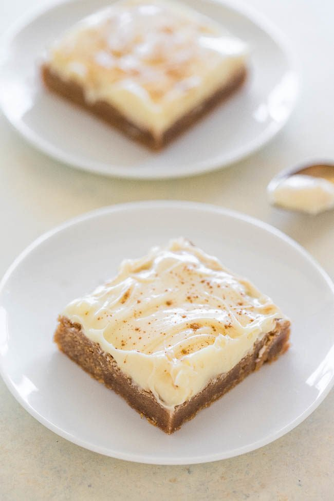 Cinnamon Roll Bars with Cream Cheese Frosting - All the flavor of cinnamon rolls, minus the work!! EASY, super soft, chewy, and the FROSTING truly is the icing on the cake!!
