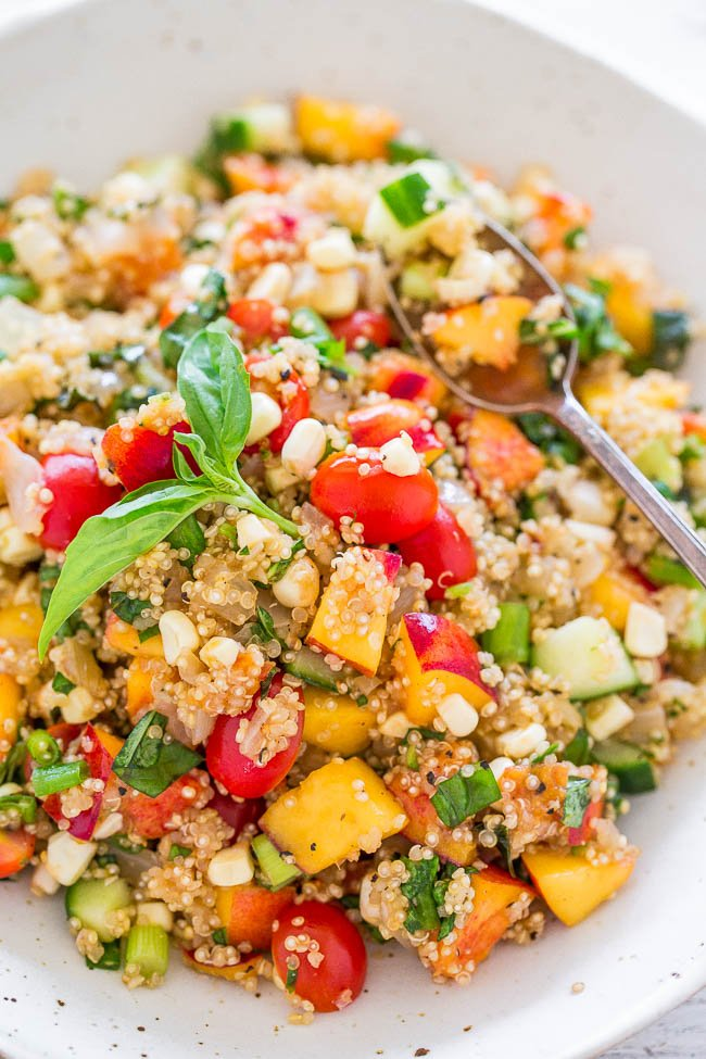 Garden Fresh Summer Quinoa Salad — Loaded with everything fresh, light, healthy, and SUMMERY!! Great for parties, potlucks, and lunch boxes because there's no mayo! Make this EASY and flavorful dish before summer disappears!!