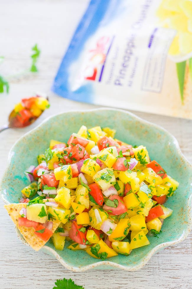 Pineapple Salsa in blue bowl with chip