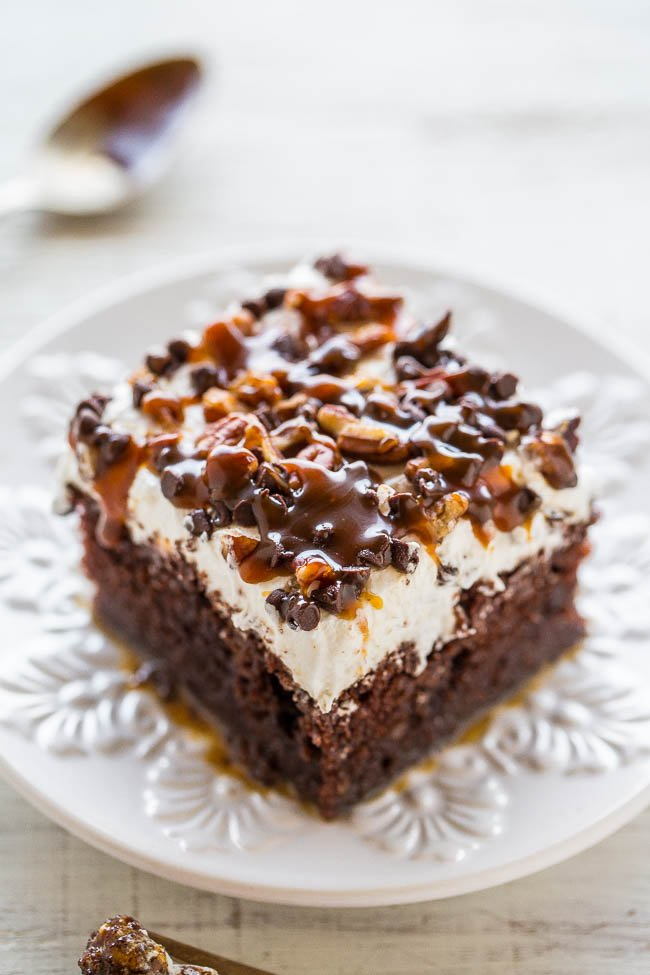 slice of chocolate turtle poke cake on white plate