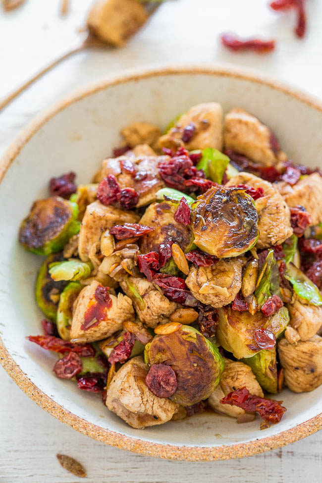 Balsamic Chicken, Brussels Sprouts, Cranberries and Pumpkin Seeds - EASY, hearty, HEALTHY, one-skillet dish that's ready in 20 minutes!! Juicy chicken, crisp-tender sprouts, chewy cranberries and crunchy pumpkin seeds!