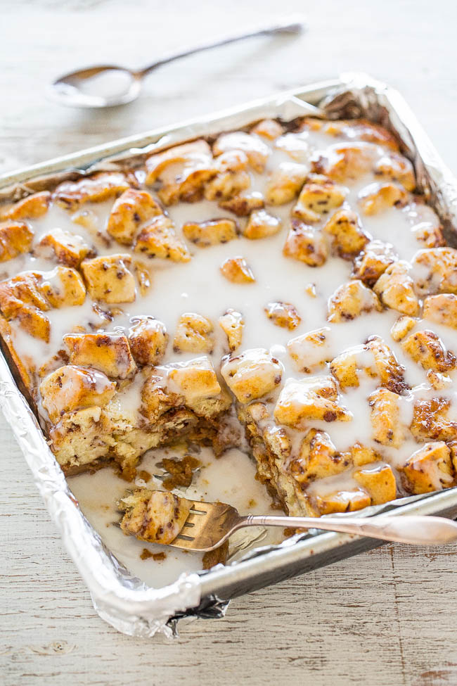 Pumpkin Cinnamon Roll Bake in a baking dish. one slice is missing.