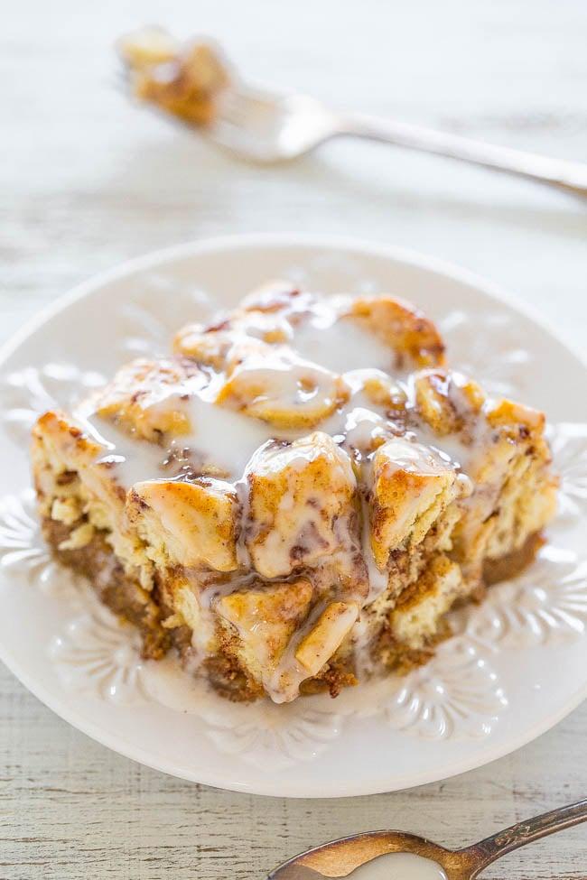 slice of pumpkin cinnamon roll breakfast casserole on a white plate