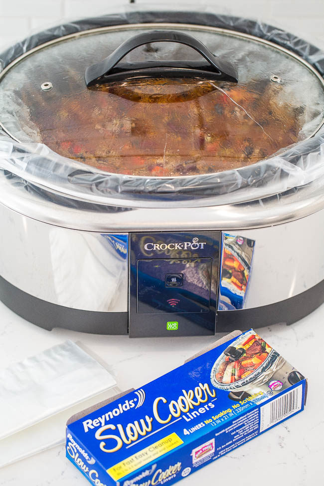 Slow Cooker Beef Chili - EASY, hearty, comfort food!! As the chili simmers in your slow cooker it develops so much FLAVOR! A foolproof chili recipe that you'll want to add into your regular rotation!!