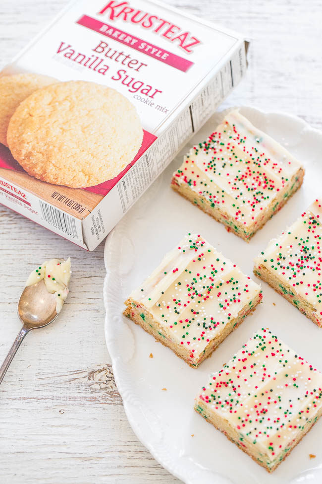 Holiday Sugar Cookie Bars with Cream Cheese Frosting - Sugar cookies in bar form with SPRINKLES baked in and on top!! So much faster than making cookies and a great holiday baking SHORTCUT!!