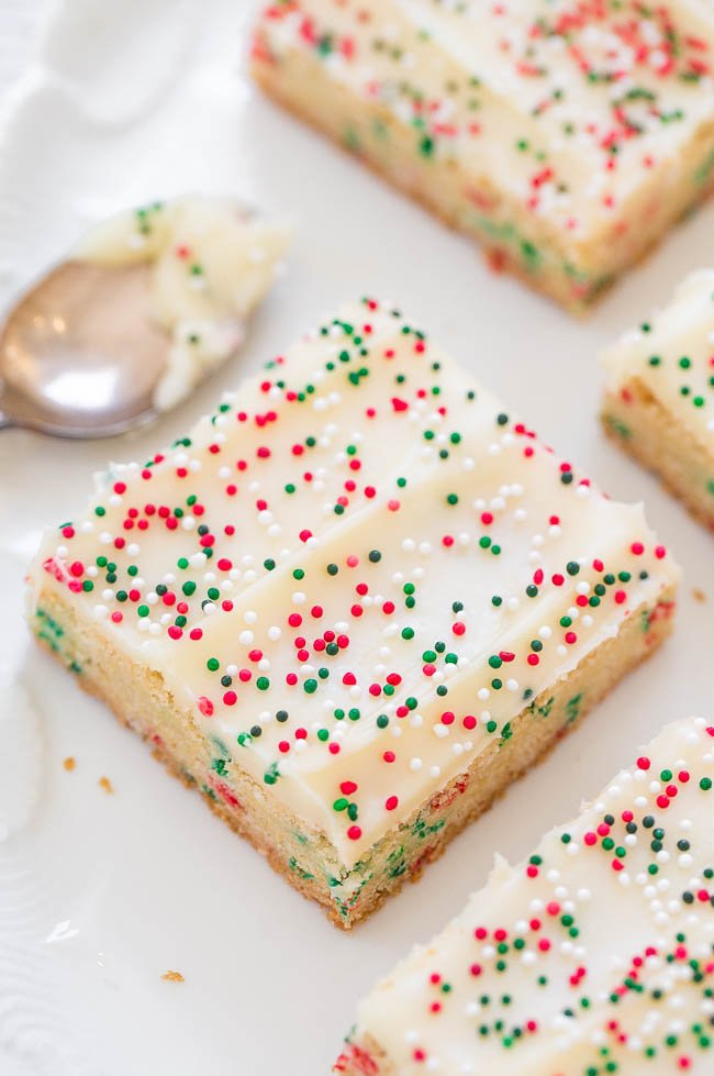 close up of Christmas cookie bars on a white platter