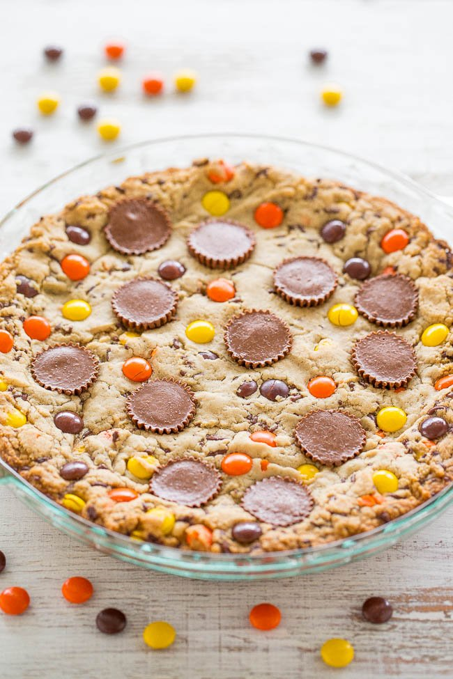 a loaded peanut butter cookie cake in a glass pie plate