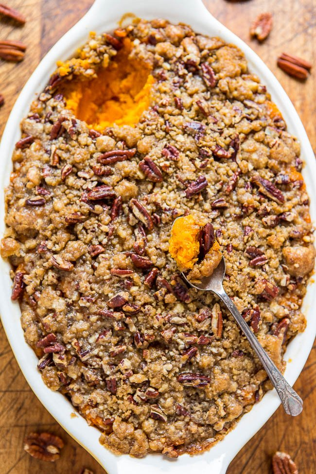sweet potato casserole with pecan topping in white baking dish