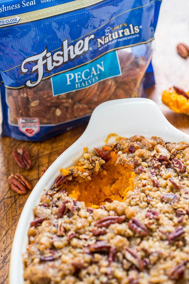 the best sweet potato casserole in white baking dish next to bag of Fisher pecans