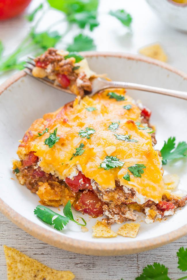 slice of Beef Taco Pie on plate with fork