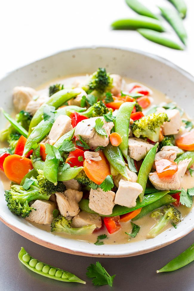 Thai Coconut Chicken Stir Fry - Chicken, sugar snap peas, bell peppers, and carrots simmered in a rich coconut milk broth that
