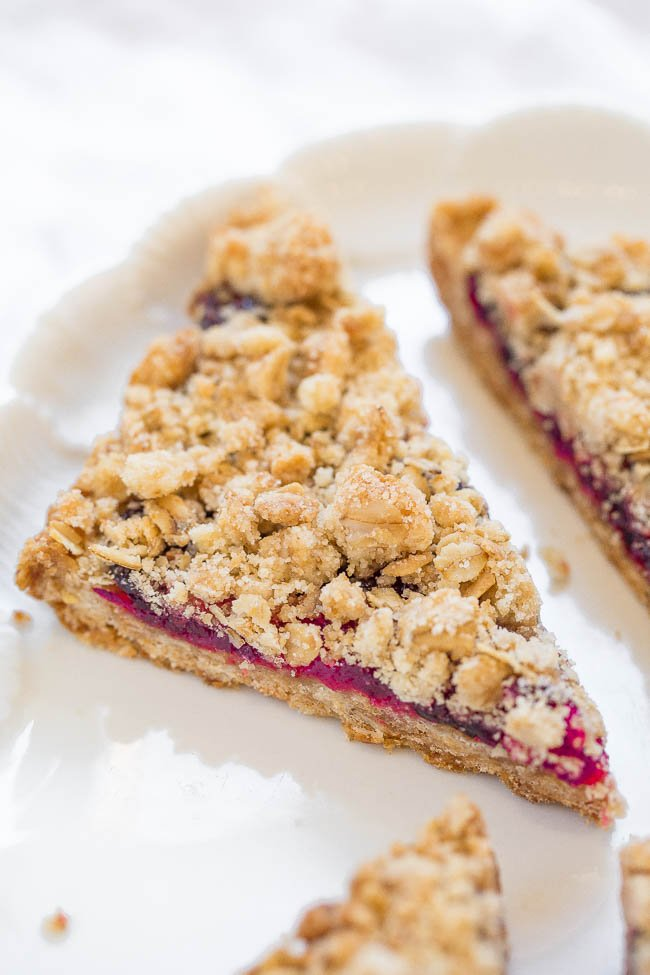 close up of a cranberry crumble bar on a white platter