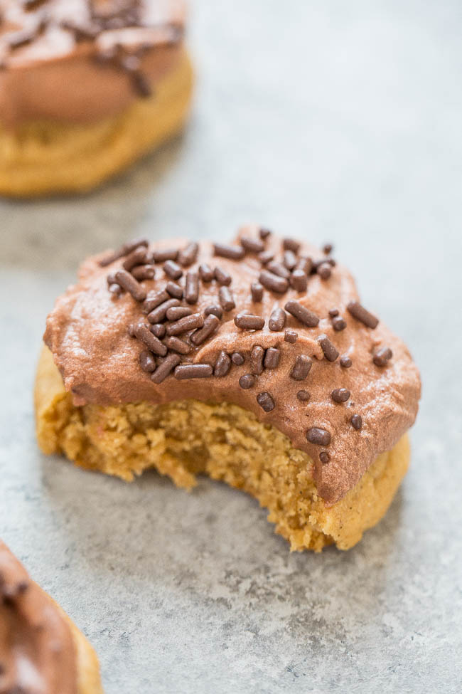 close up of frosted chewy peanut butter cookie with bite missing