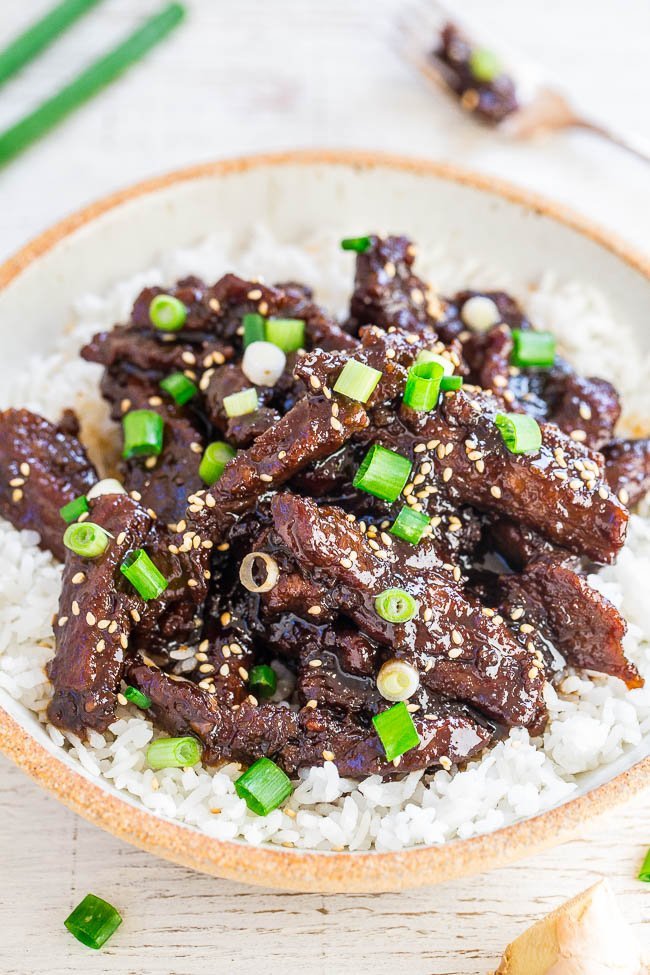 P.F. Change's Mongolian Beef garnished with green onions atop white rice in large bowl