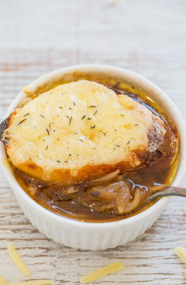 A ramekin and spoonful of Easy One-Hour French Onion Soup