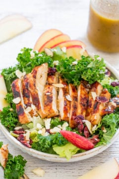 A white bowl filled with Apple, White Cheddar, and Grilled Chicken Salad