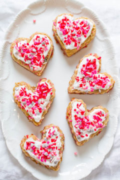 Overhead shot of Soft Frosted Valentine Heart Cookies on a white plate