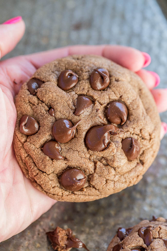 a Nutella chocolate chip cookie being held aloft