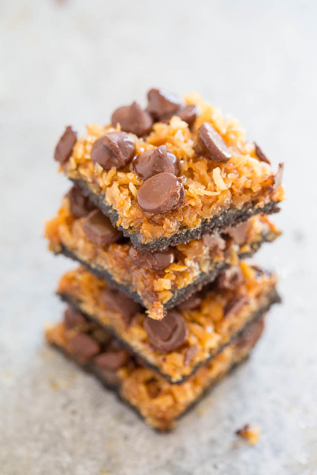 Better-Than-Girl-Scout Samoas Cookie Bars — Resembles Samoas but BETTER!! Thesecoconut caramel cookie bars feature an Oreo crust topped with coconut, chocolate chips, and drenched in salted caramel!! Chewy, rich, decadent, and EASY!!