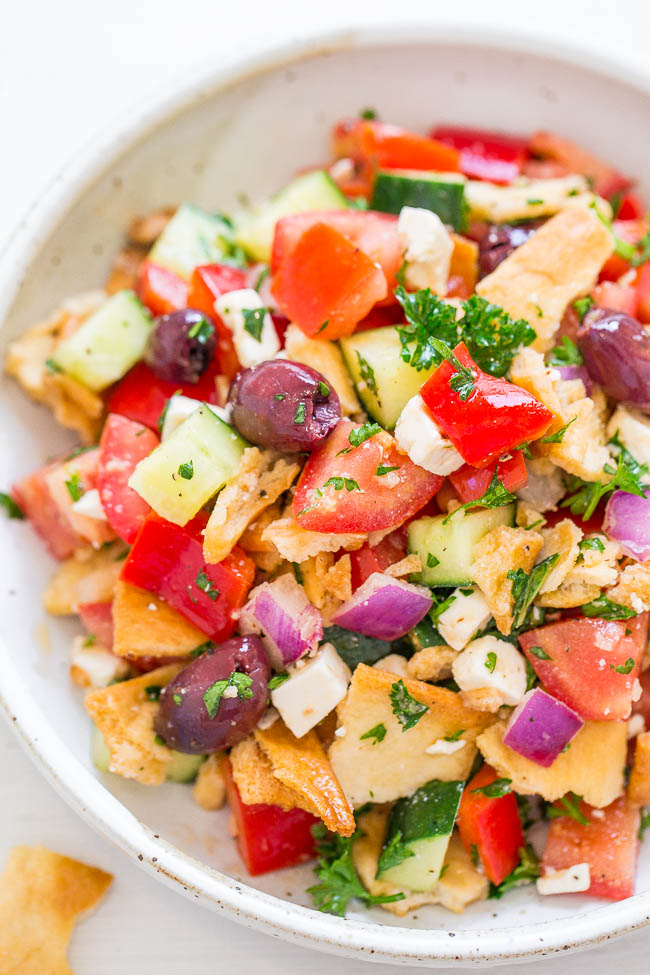 overhead view of chopped greek salad with pita chips