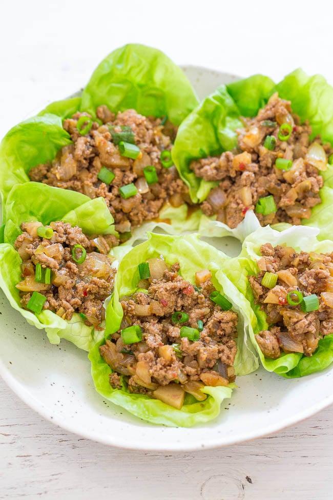 five copycat pf changs lettuce wraps on a white plate