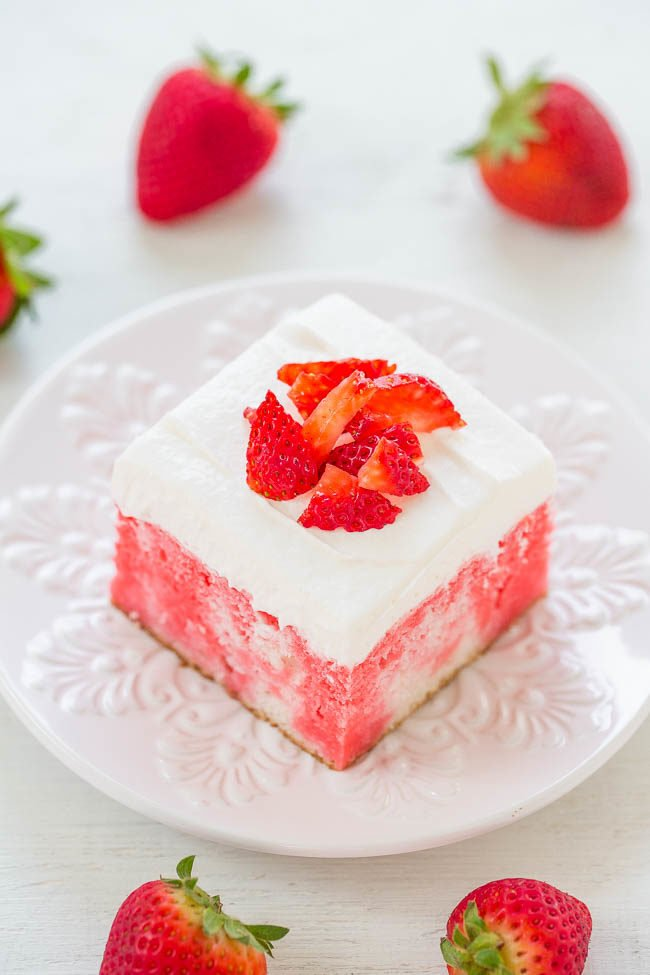Overhead slice of Strawberry Poke Cake topped with diced strawberries