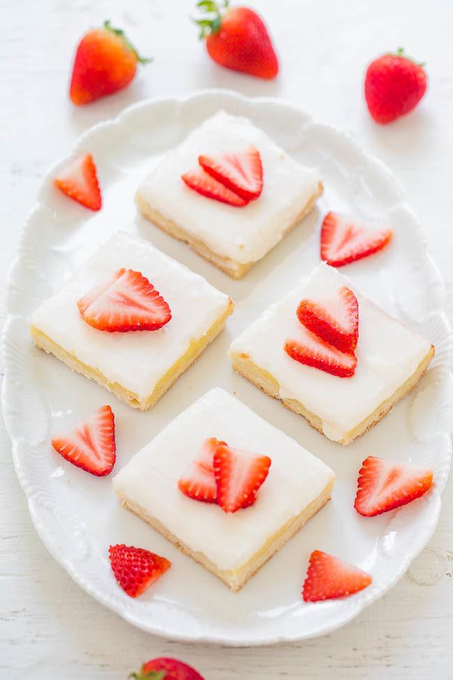 Strawberry Cream Cheese Shortbread Bars overhead on white platter