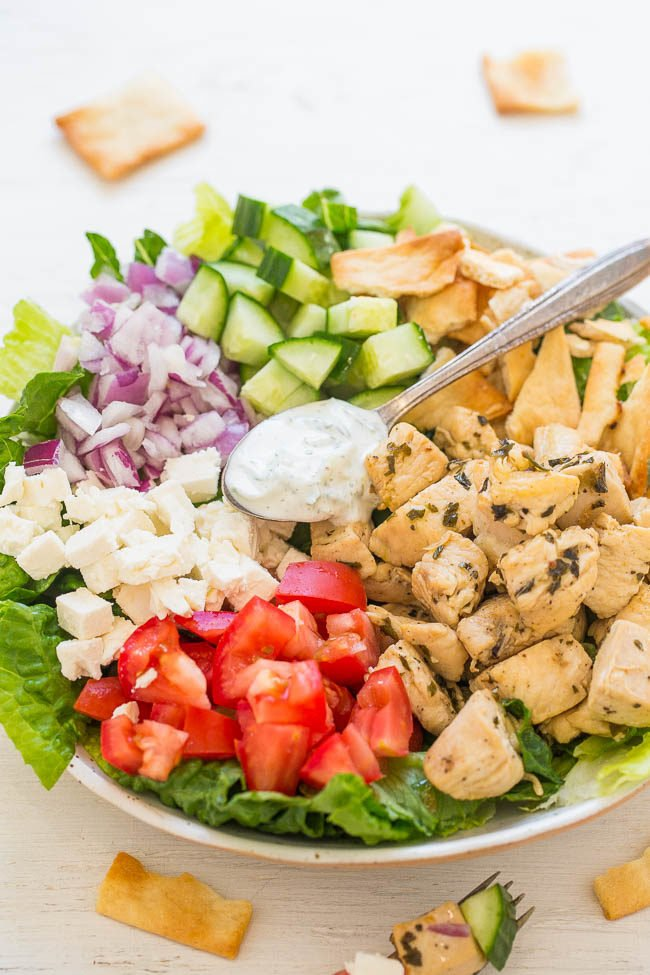 Chicken Gyro Salad with Tzatziki Sauce - Chicken gyros transformed into a HEALTHY salad with an EASY homemade tzatziki sauce that's loaded with tangy dill FLAVOR!! Ready in 20 minutes!!