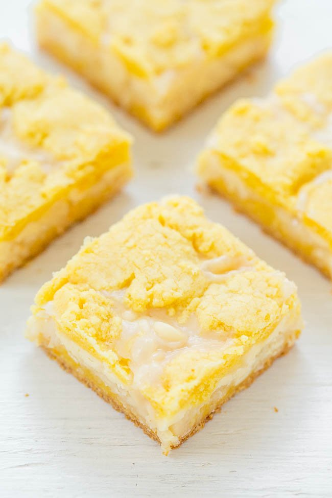 Gooey Lemon Coconut Bars — If you like traditional lemon bars, you'll LOVE this EASY recipe for soft, chewy, and oh-so-gooey lemon bars!! Loaded with white chocolate and coconut!!