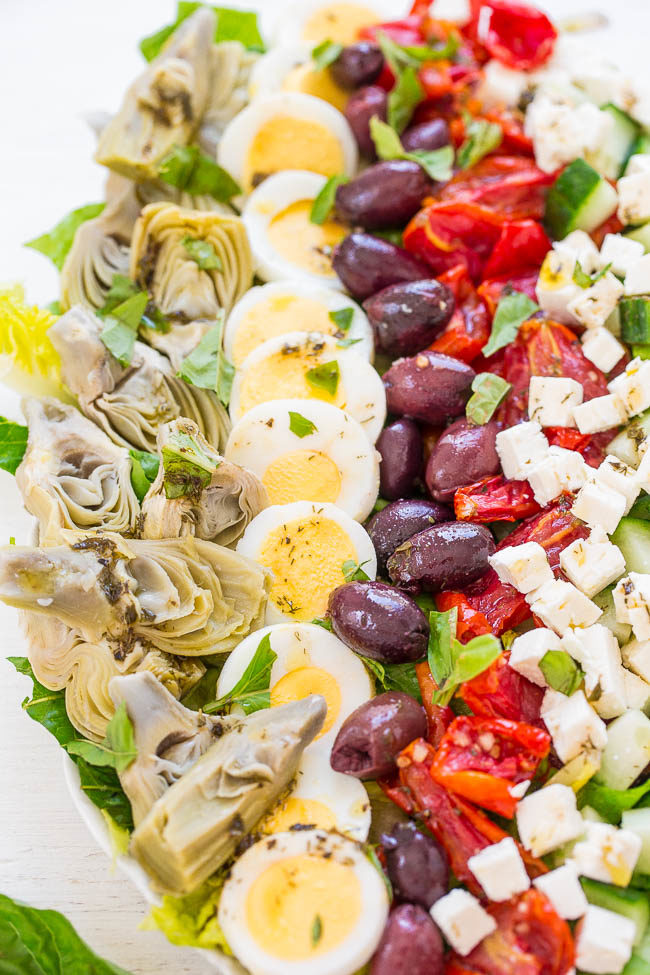 Mediterranean Cobb Salad - An EASY, HEALTHY, Mediterranean twist on classic Cobb salad that's ready in 10 minutes!! Artichokes, olives, peppers, cucumbers, feta, and more! The vinaigrette is light yet flavorful and DELISH!!