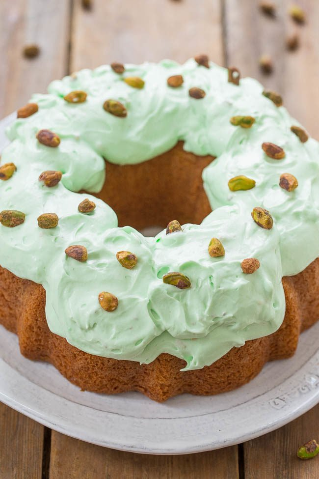 Pistachio Double Pudding Cake - There's pistachio pudding in the soft cake AND in the fluffy whipped frosting!! Pistachio fans are going to love this retro-inspired cake that's EASY and DELICIOUS!!