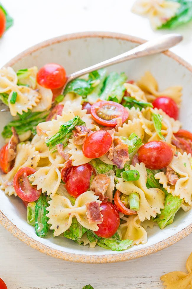 BLT pasta salad in white bowl with fork