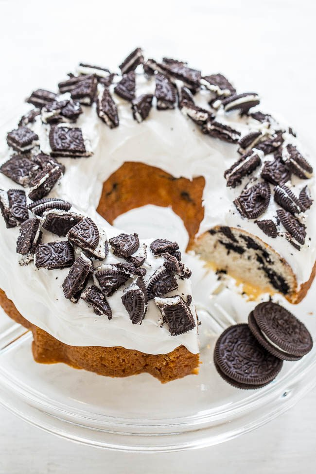 Cookies and Cream Bundt Cake - Extremely EASY white cake that's LOADED with Oreos, decadent vanilla frosting, and sprinkled with MORE Oreos!! A partytime favorite!!