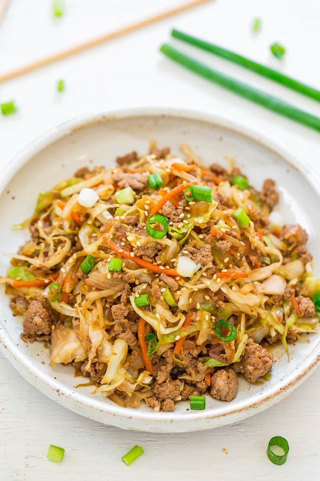 Chicken Egg Roll Bowls - Deconstructed egg roll bowls REDUCE the calories, fat, and carbs of traditional egg rolls without sacrificing flavor!! EASY, ready in 15 minutes, and way BETTER than takeout!!