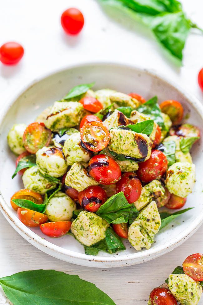 A white bowl of Pesto Chicken Caprese Salad
