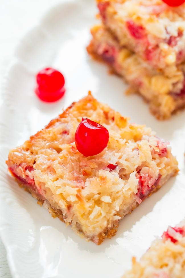 Pineapple Coconut Bars — Eat your piña colada rather than drinking one with these fast, EASY, no-mixer bars that taste TROPICAL!! Pineapple, coconut, white chocolate, and cherries!!