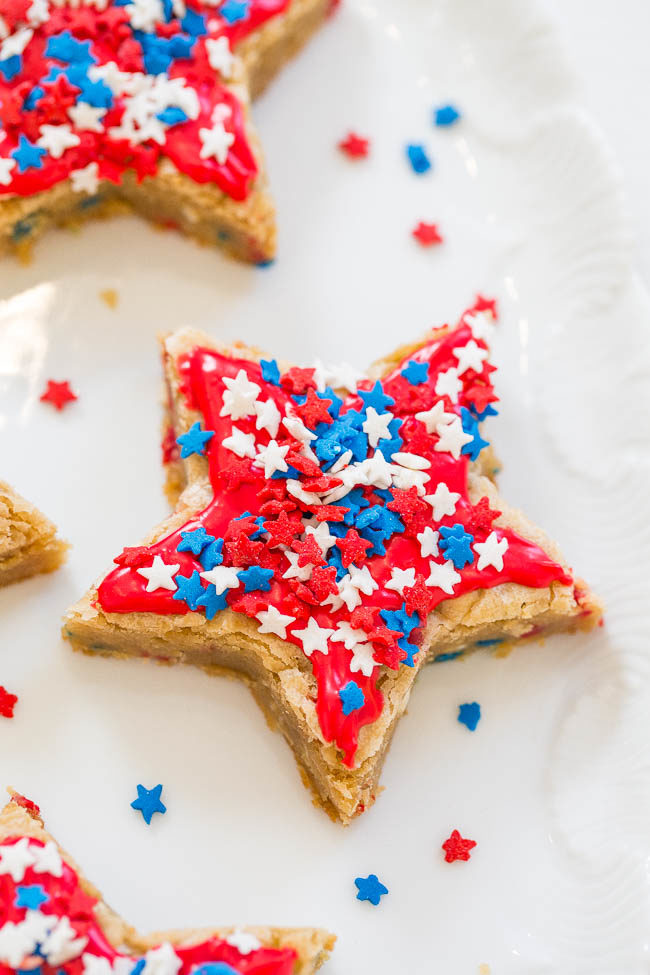Red, White, and Blue Star Cookies - Get patriotic with these SOFT, chewy, frosted star cookies that are loaded with SPRINKLES!! No rolling pin required! They're a holiday WINNER!!