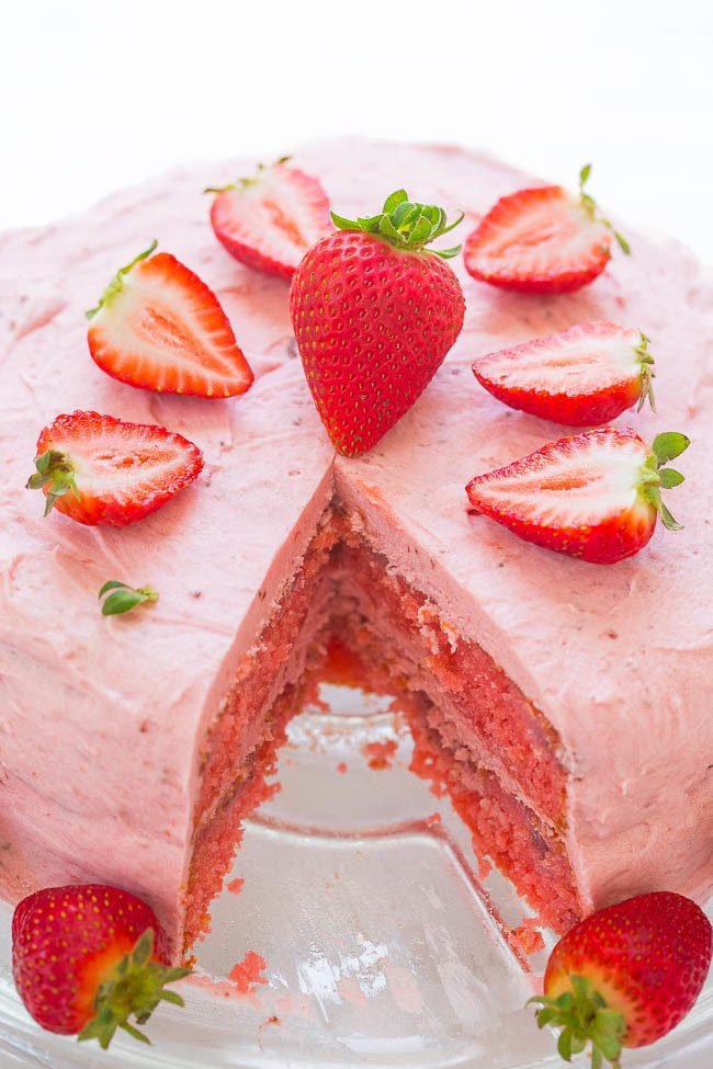 Strawberry Layer Cake with Strawberry Frosting - Soft, tender cake loaded with FRESH strawberries and a sweet strawberry frosting!! An EASY layer cake that's perfect for parties! Strawberry fans will LOVE IT!!