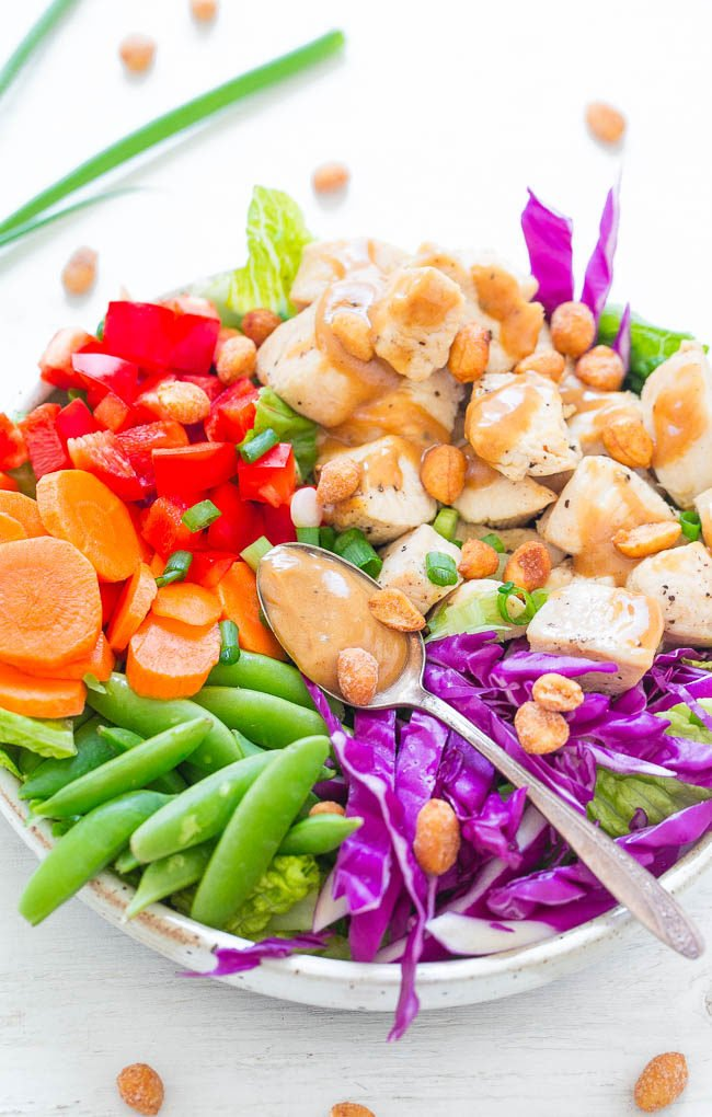 Thai Peanut Chicken Salad - Eat the RAINBOW with this EASY, healthy salad that's ready in 20 minutes!! Juicy chicken and crisp vegetables are tossed in the BEST PEANUT SAUCE ever!!