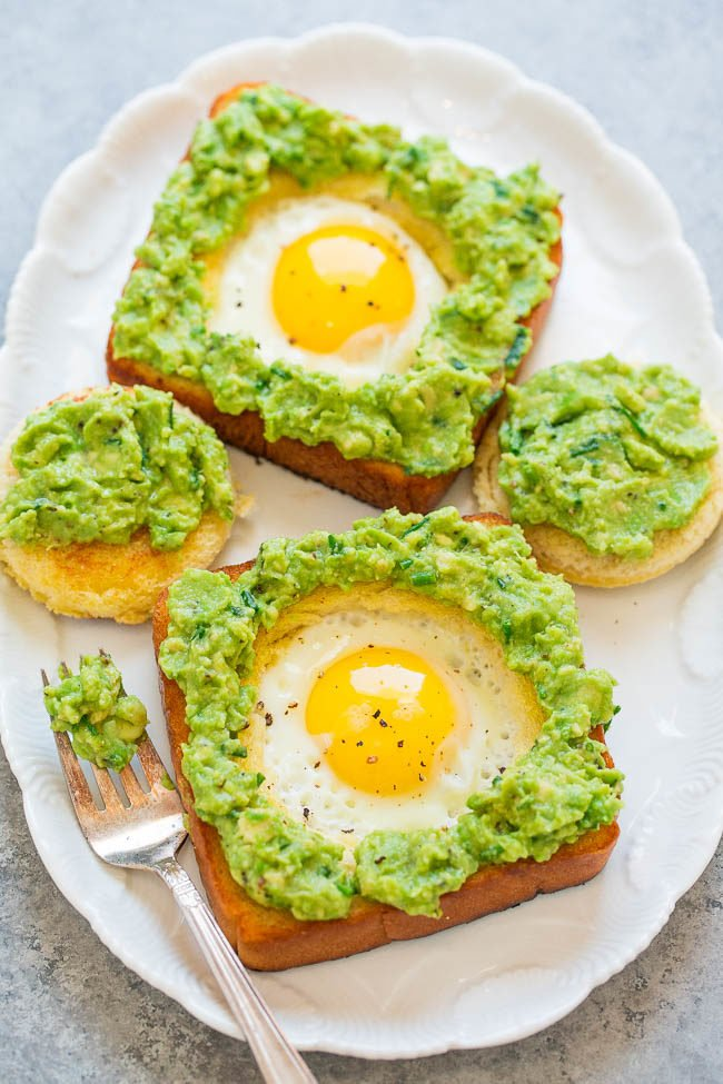 Egg-In-A-Hole Avocado Toast - Slathering warm egg-in-a-hole toast with a creamy chive and lime-scented avocado spread is beyond DELICIOUS!! It's an EASY recipe that's ready in 15 minutes and is perfect ANYTIME!!