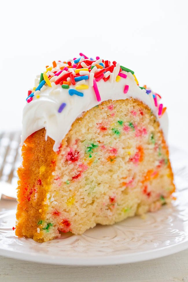 Slice of Easy Homemade Funfetti Bundt Cake on a white plate
