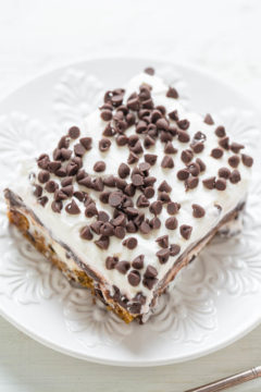Overhead shot of Chocolate Chip Cookie Chocolate Lasagna on a white plate