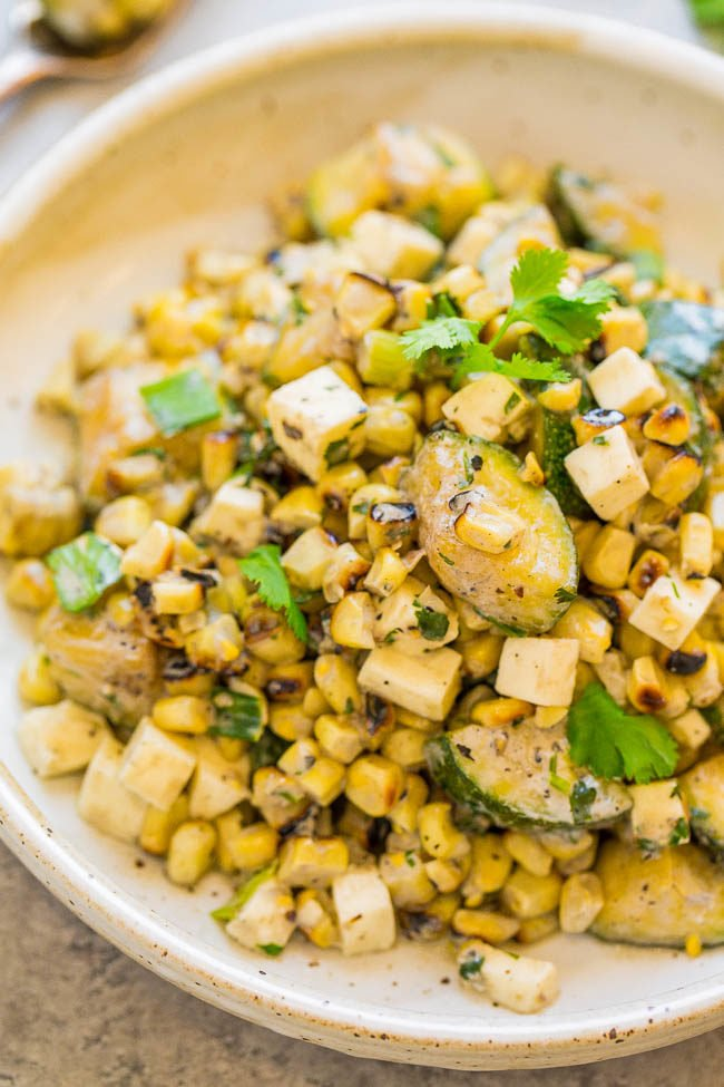 Creamy Mexican Grilled Corn and Zucchini Salad - A healthy EASY salad that's ready in 15 minutes and so flavorful!! Corn, zucchini, cilantro, queso fresco and more are tossed in a DELISH creamy lime sauce!!