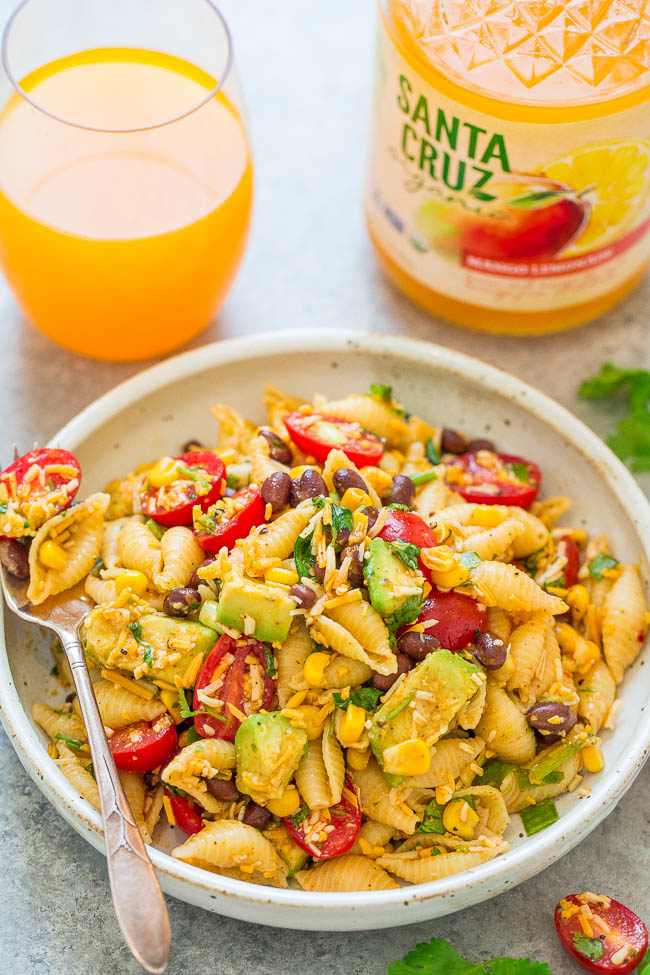 Taco Pasta Salad - EASY, ready in 20 minutes, and loaded with great Mexican-inspired ingredients including corn, black beans, tomatoes, cilantro, avocado, and more!! Perfect for picnics, parties, and potlucks!!