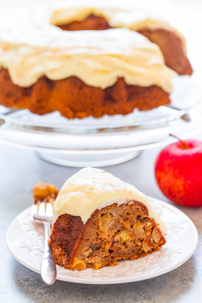 A slice of Apple Spice Cake with Cream Cheese Frosting on a white plate