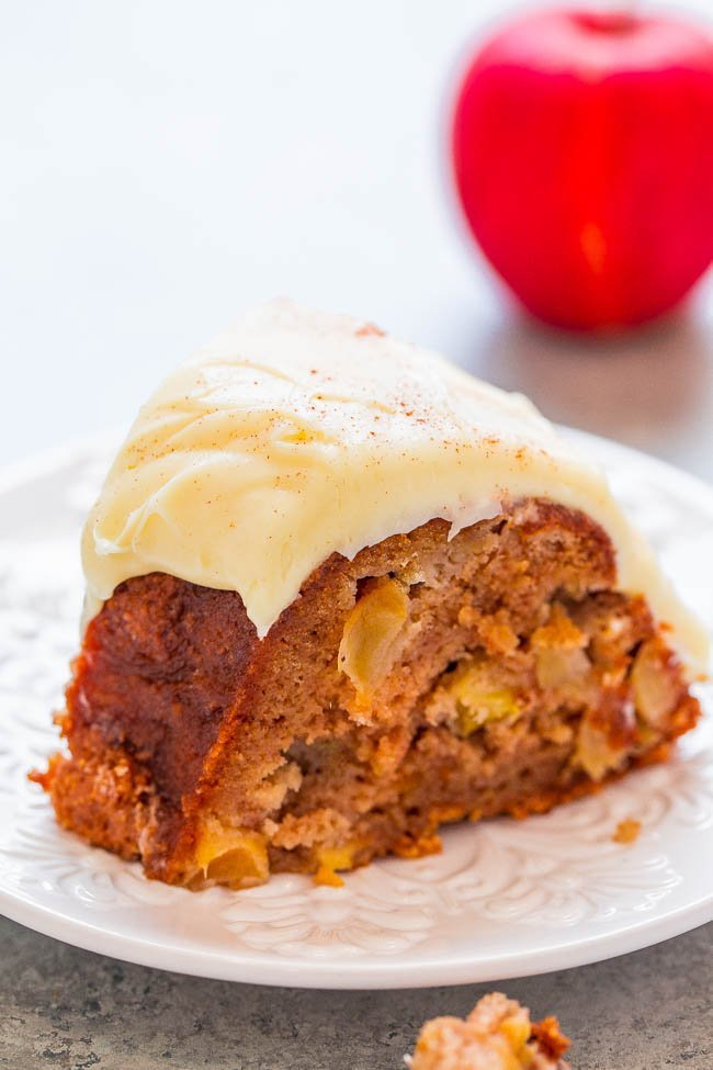 Apple Spice Cake with Cream Cheese Frosting on white plate