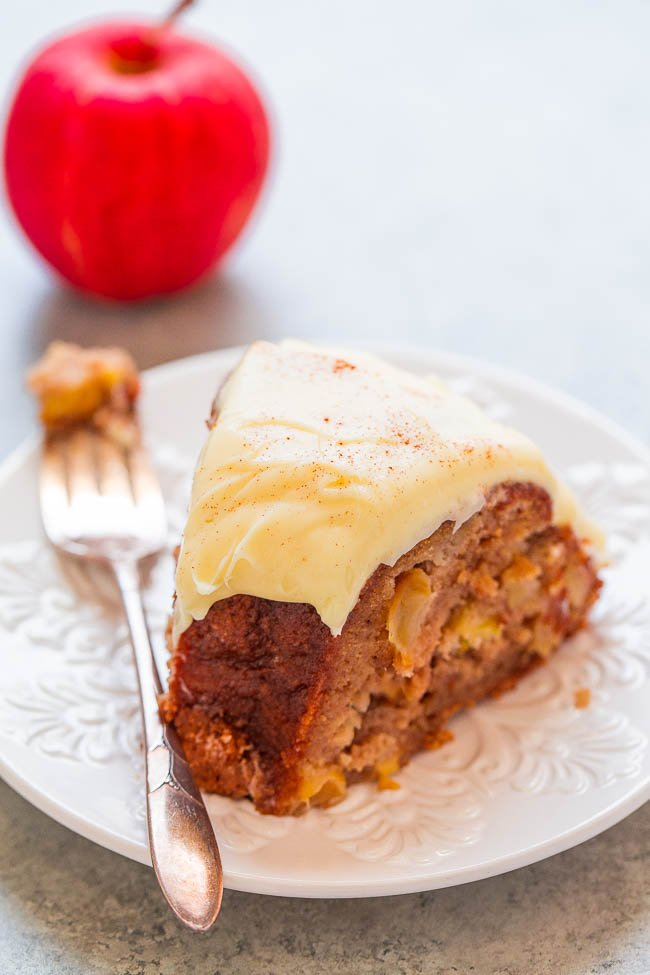 slice of fresh Apple Cake with Cream Cheese Frosting on white plate