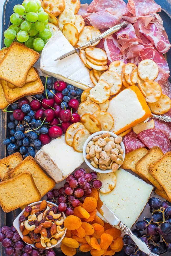Overhead shot of a The Best Cheese Board with fruits and nuts